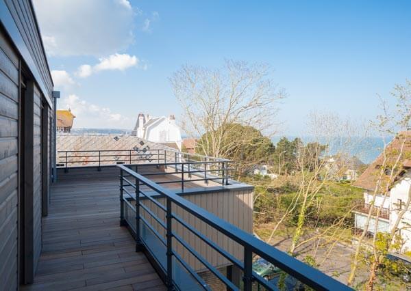 Maison ossature bois balcon