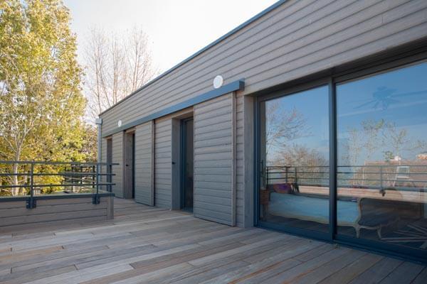 Maison ossature bois terrasse balcon